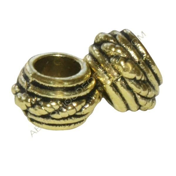 Entrepieza tonel dorada de 4,5 x 6 mm cordoncillo