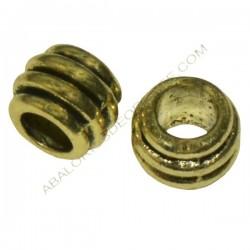 Entrepieza tonel gallonada dorada de 6 x 7 mm