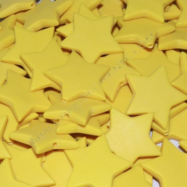 Cuenta acrílica estrella amarillo 27 x 27 x 5 mm