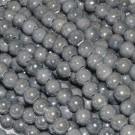 Bola de cerámica titanizada gris de 8 x 8,9 mm.