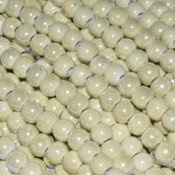 Bola de cerámica titanizada beige de 8 x 8,9 mm.