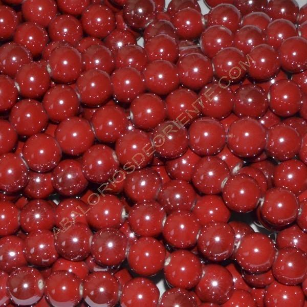 Bola de cerámica titanizada roja de 10 x 10 mm.