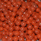 Bola de cerámica titanizada naranja de 10 x 10 mm.
