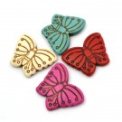 Mariposa en colores variados de turquesa sintética