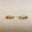 Pendientes de plata 925 chapados en oro tres estrellas unidas